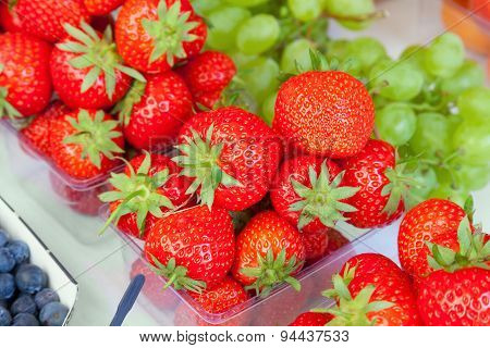 Food Market Display Of Strawberries Ready To Eat.
