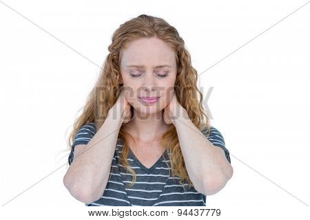 A blonde woman having neck pain on white background