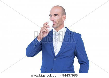 Happy businessman drinking cup of coffee before work