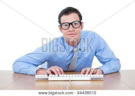 Businessman typing at his desk on white screen background