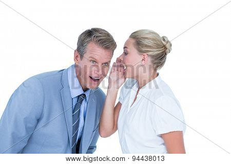 Businessman telling secret to a businesswoman against a white screen