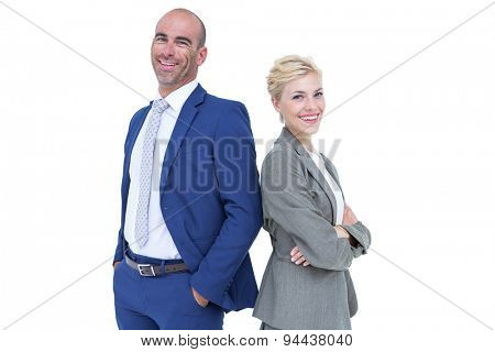 Smiling business people back-to-back with arms crossed