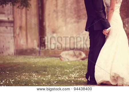 Close Up Of A Bride And Groom Holding Hands
