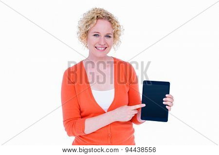 Happy pretty blonde showing tablet computer on white background