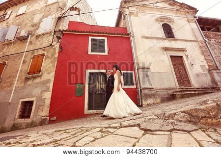 Bride And Groom Walking On Streets