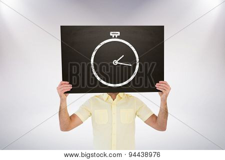 Casual man showing board against grey background