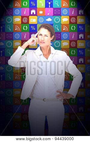 Thinking businesswoman against app wall