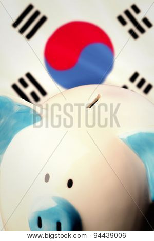 Piggy bank against korea republic national flag