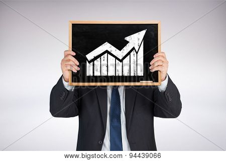Businessman showing board against grey background