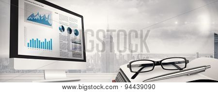 Business interface against room with large window looking on city