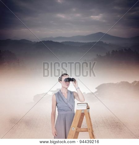 Businessman looking on a ladder against misty forest