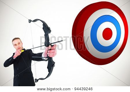 Concentrated businessman shooting a bow and arrow against white background with vignette