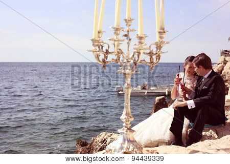 Bride And Groom Near Ocean
