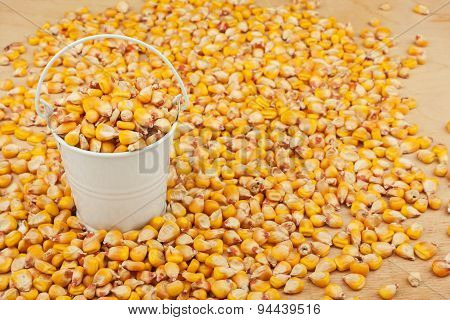 White Bucket With Corn On The Wooden Floor