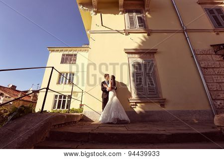 Bride And Groom Kissing In The Sunlight