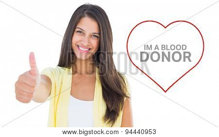 Happy casual woman showing thumbs up against blood donation