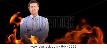 Businessman looking at the camera against black