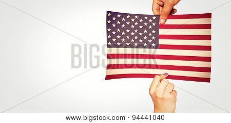 Hands showing against usa national flag