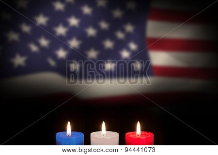 Candles on black background against united states of america flag