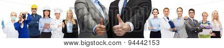 business, people, cooperation, success and gesture concept - businessman and businesswoman showing thumbs up over representatives of different professions background