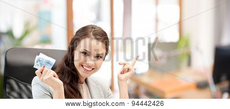 finances, people, savings and investment concept - happy business woman with euro cash money over office room background