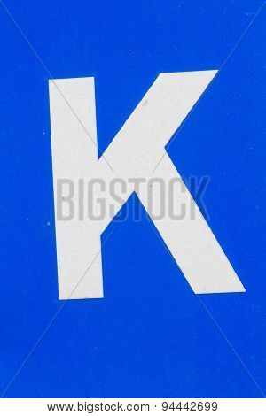 White Letter K From Traffic Road Sign