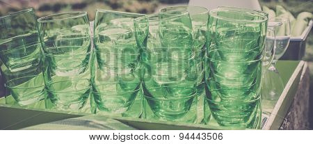 Green Clear Glasses Stacks On The Table In A Cafe
