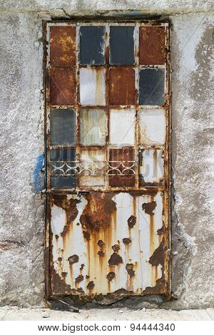 Old decorated rusty door in decay