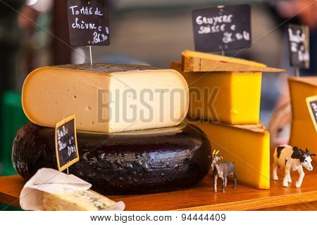 Chunks Of Different Cheeses At A French Market