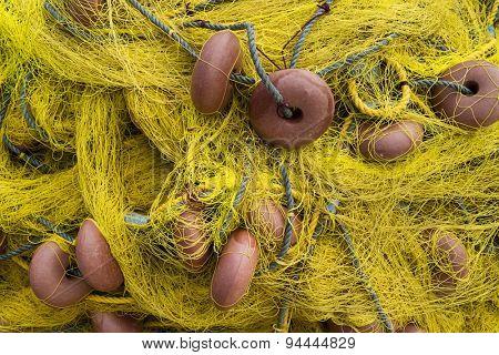 Old dry yellow fishing nets