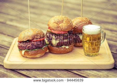 Tasty grilled burger and glass of cold beer