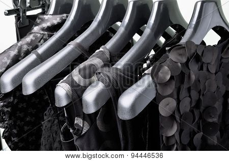 Black Womens Clothing Hanging On The Black Plastic Hanger Horizontal