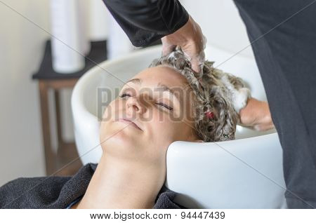 Woman Having Her Hair Shampooed