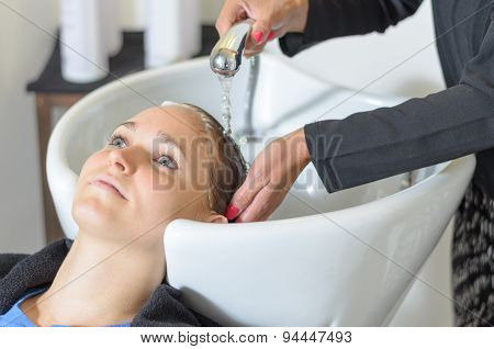 Young Woman At The Hairdressing Salon