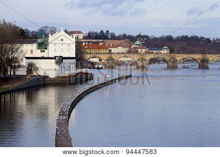 Winter View Of Vltava River Near Charles Bridge With Breakwater