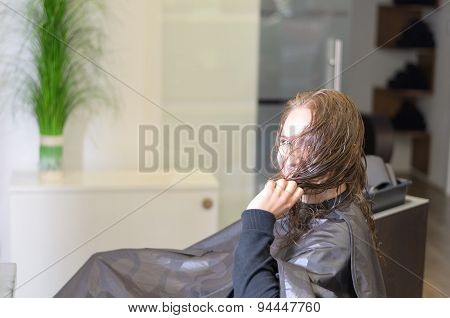 Young Woman Wearing Salon Cape Inside The Parlor