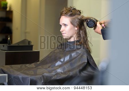 Teen Girl In Salon Drying Her Hair With Blow Dryer