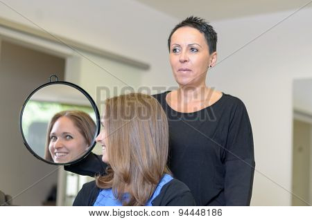 Girl Looking At Herself On Hairdresser's Mirror