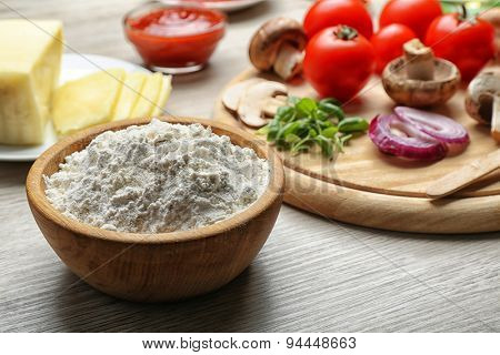 Ingredients for cooking pizza on wooden table, closeup