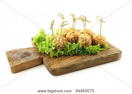Meat balls on wooden cutting board isolated on white