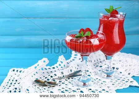 Frozen Strawberry dessert in glass, on color wooden background