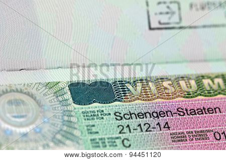 Closeup of the Schengen visa to Austria, Germany with shallow DOF