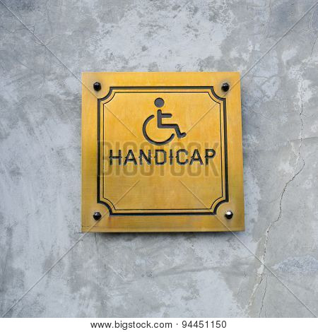 Disabled Handicap Icon And Wording Handicap Sign Made From Gold Metal Board