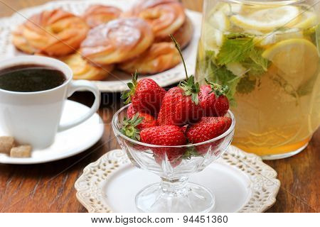 Breakfast with coffee, cake, strawberry