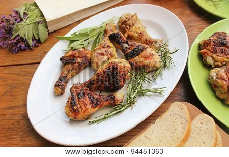Grilled chicken legs on table