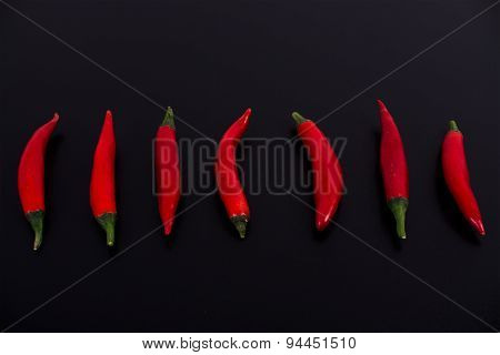 Red chilies On A Black Background