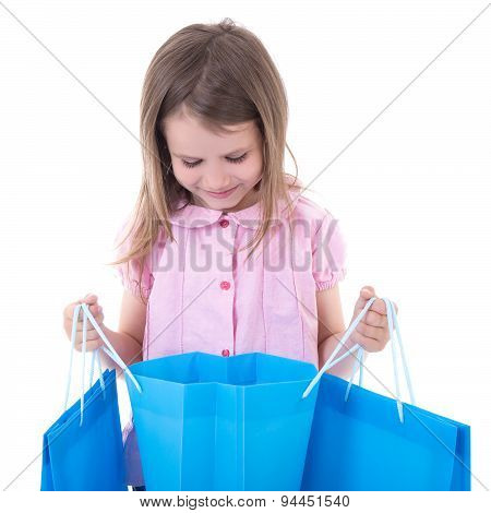 Shopping Concept - Cute Little Girl With Bags Isolated On White