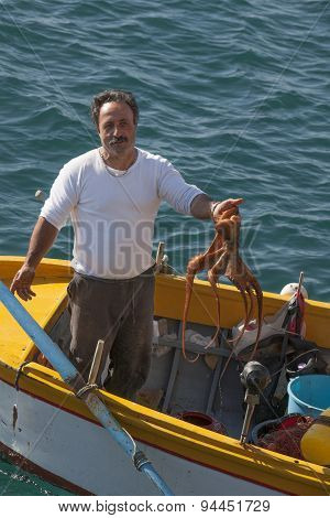 Italien Fisherman And His Catch