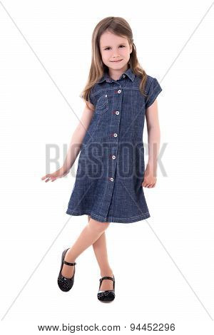 Cute Little Girl In Denim Dress Posing Isolated On White
