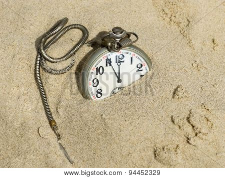 Pocket Watch Buried In Sand.